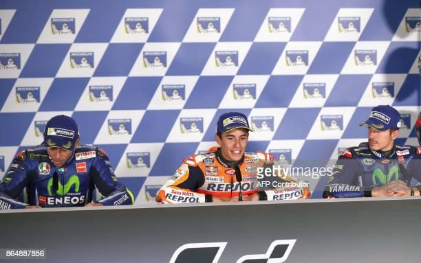 Winner Honda rider Marc Marquez of Spain secondplaced Yamaha rider Valentino Rossi of Italy and thirdplaced Yamaha rider Maverick Vinales of Spain...