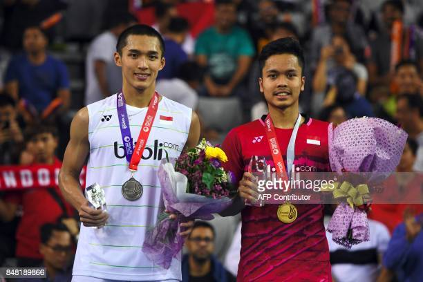 Winner Indonesia's Anthony Sinisuka Ginting and runner up Indonesia's Jonatan Christie pose on the podium during an awards ceremony after the men's...