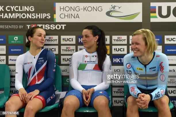 Winner Italy's Rachele Barbieri runner up Britain's Elinor Barker and second runner up Belgium's Jolien d'Hoore chat before stepping towards the...