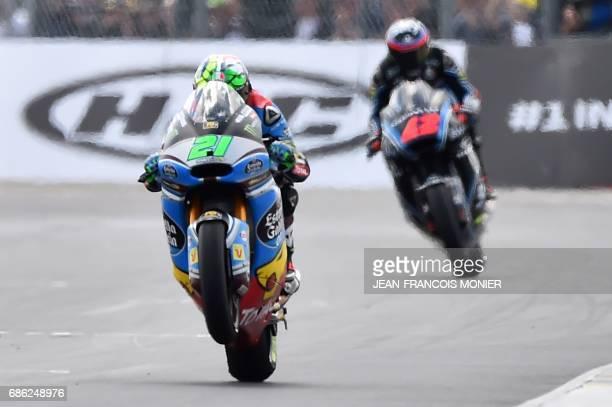 Winner Italy's rider Franco Morbidelli celebrates on his Kalex Estrella Galicia 00 Marc VDS N°21 ahead of Italy's rider Francesco Bagnaia on his Sky...