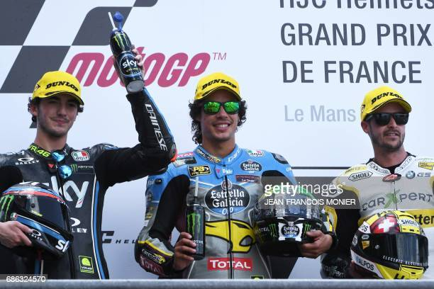 Winner Italy's rider Franco Morbidelli celebrates with second placed Italy's rider Francesco Bagnaia and third placed Swiss Thomas Luthi on the...