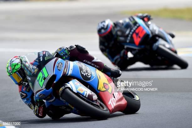Winner Italy's rider Franco Morbidelli competes on his Kalex Estrella Galicia 00 Marc VDS N°21 ahead of Italy's rider Francesco Bagnaia on his Sky...