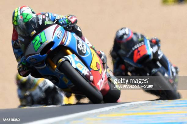 Winner Italy's rider Franco Morbidelli competes on his Kalex Estrella Galicia 00 Marc VDS N°21 ahead of Italy's rider Francesco Bagnaia on his Sky...