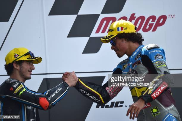 Winner Italy's rider Franco Morbidelli shakes hands with second placed Italy's rider Francesco Bagnaia on the podium after the Moto2 race of the...