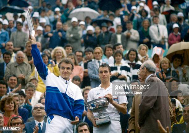 Winner Ivan Lendl of Czechoslovakia and Runnerup Mats Wilander of Sweden pose with their trophies after the final of the French Open Tennis...