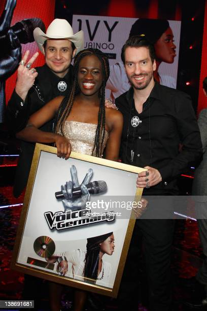 Winner Ivy Quainoo celebrates with Sascha 'Hoss Powers' Vollmer and Alec 'Boss Burns' Voelkel of the band The BossHoss after the music tv show 'The...