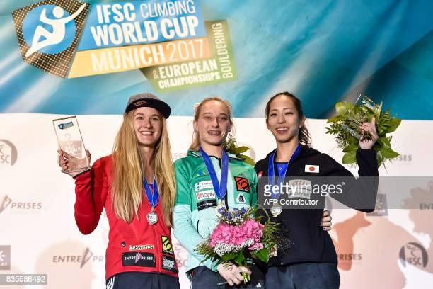 Winner Janja Garnbret of Slovenia secondplaced Shauna Coxsey of Great Britain and third placed Akiyo Noguchi of Japan of Japan pose on the podium...