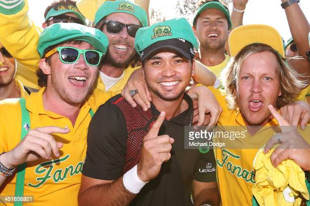Winner Jason Day of Australia poses with the Fanatics during day four of the World Cup of Golf at Royal Melbourne Golf Course on November 24 2013 in...