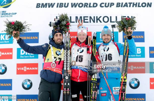 Winner Johannes Thingnes Boe from Norway flanked by second placed Martin Fourcade from France and third placed Anton Shipulin from Russia on the...