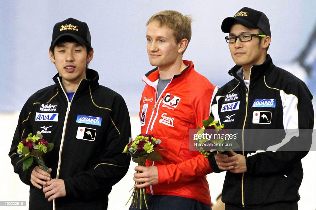 Winner Joji Kato (R) of Japan, runners-up Ryohei Higa (L) of Japan and Jamie Gregg (C) of Canada pose for photographs after Men's 500m during day one of the ISU World Sprint Championships at the Utah Olympic Oval on January 26, 2013 in Salt Lake City, Utah.