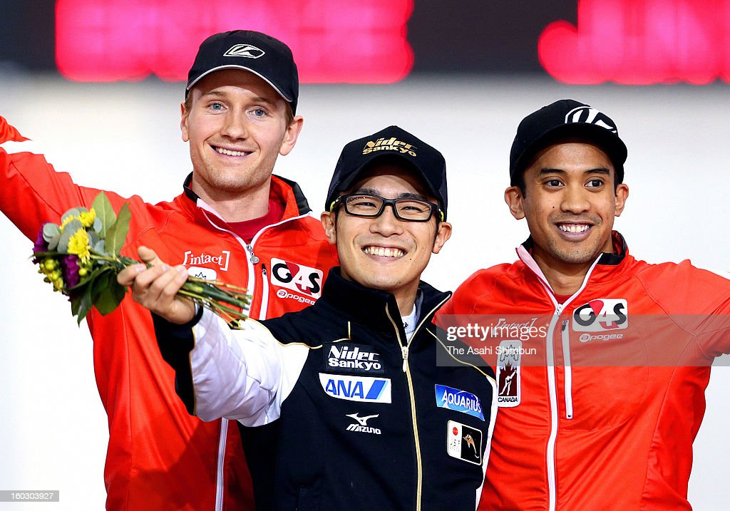 Winner Joji Kato (C) of Japan, second place Jamie Gregg (L) of Canada and third place Gilmore Junio of Canada pose for photographs on the podium after the Men's 500m during day two of the ISU World Sprint Championships at the Utah Olympic Oval on January 27, 2013 in Salt Lake City, Utah.
