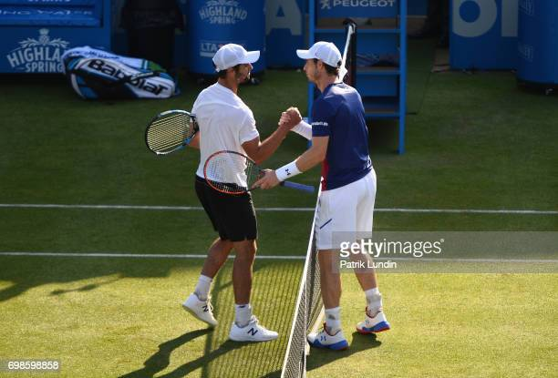 Winner Jordan Thompson of Australia speaks with runner up Andy Murray of Great Britain speak following their mens singles first round match on day...