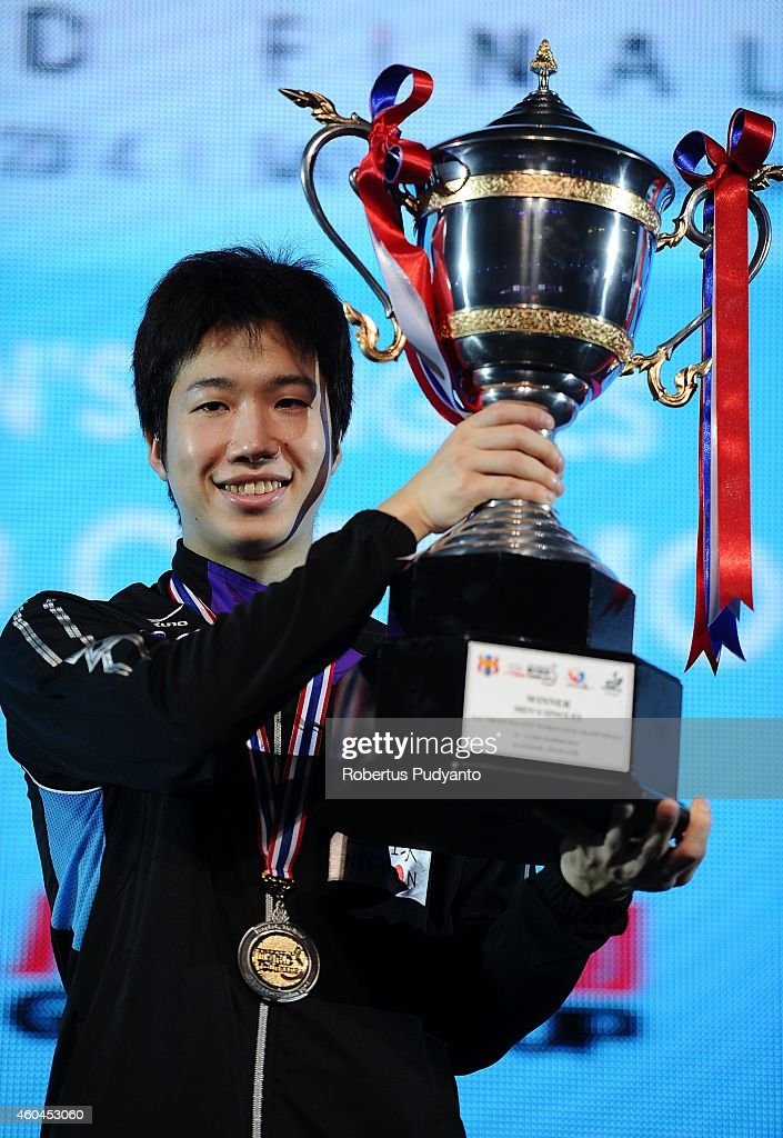 Winner Jun Mizutani of Japan poses with the trophy on the podium during the awarding ceremony of the 2014 ITTF World Tour Grand Finals at Huamark Indoor Stadium on December 14, 2014 in Bangkok, Thailand.