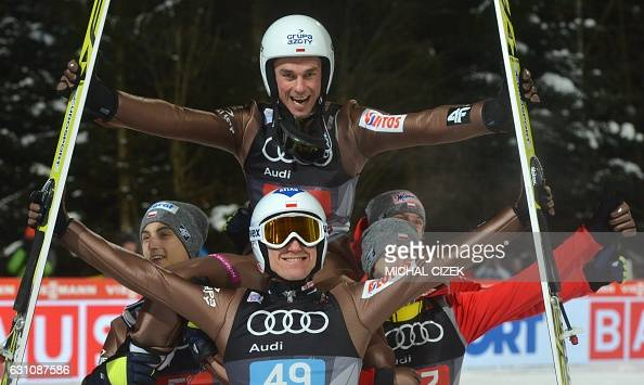 Winner Kamil Stoch of Poland celebrates in front of third placed Piotr Zyla of Poland after the Four Hills competition of the FIS Ski Jumping World...