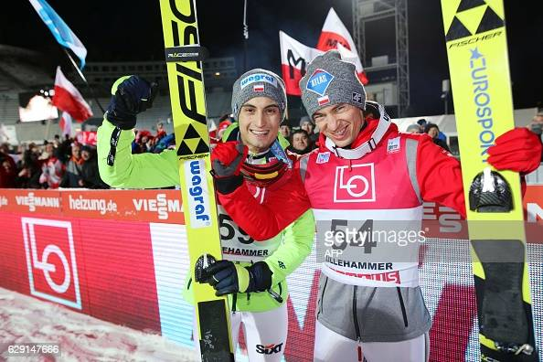Winner Kamil Stoch of Poland celebrates with his team mate Maciej Kot during the FIS World Cup Ski Jumping HS 138 competition on December 11 2016 in...
