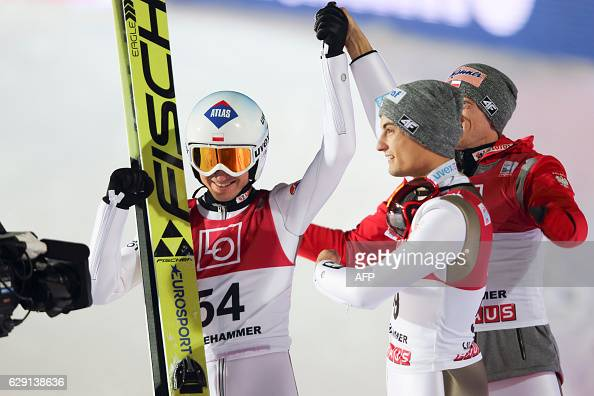 Winner Kamil Stoch of Poland celebrates with his team mates Maciej Kot and Dawid Kubacki winning the FIS World Cup Ski Jumping HS 138 competition on...