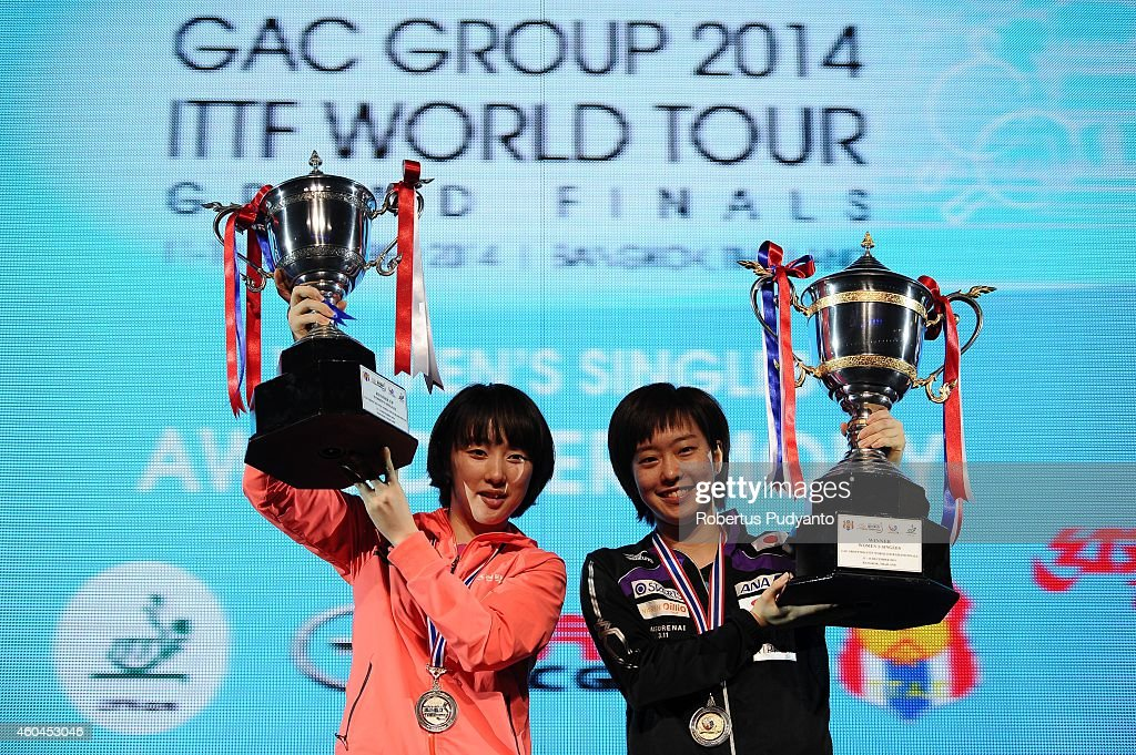 Winner Kasumi Ishikawa of Japan (R) and runner-up Seo Hyowon of Korea (L) pose with their trophies on the podium during the awarding ceremony of the 2014 ITTF World Tour Grand Finals at Huamark Indoor Stadium on December 14, 2014 in Bangkok, Thailand.