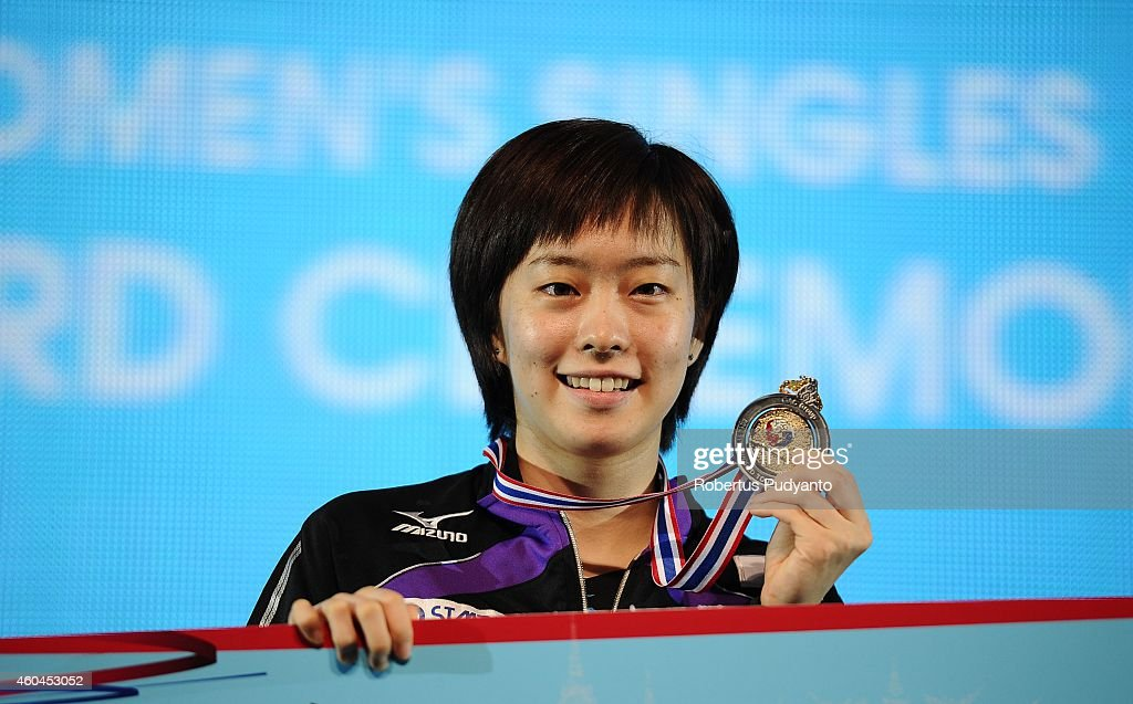 Winner Kasumi Ishikawa of Japan poses on the podium with the gold medals during the awarding ceremony of the 2014 ITTF World Tour Grand Finals at Huamark Indoor Stadium on December 14, 2014 in Bangkok, Thailand.