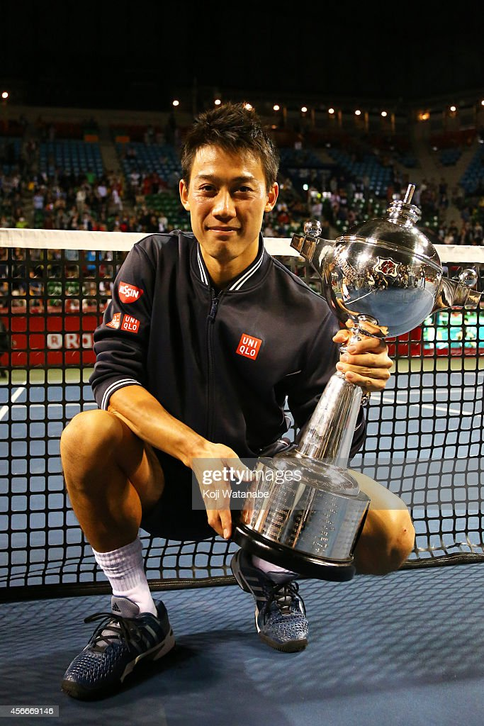 Winner Kei Nishikori of Japan celebrates with his trophy after winning the men's singles final match against Milos Raonic of Canada on day seven of Rakuten Open 2014 at Ariake Colosseum on October 5, 2014 in Tokyo, Japan.