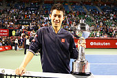Winner Kei Nishikori of Japan poses with his trophy after winning the men's singles final match against Milos Raonic of Canada on day seven of...