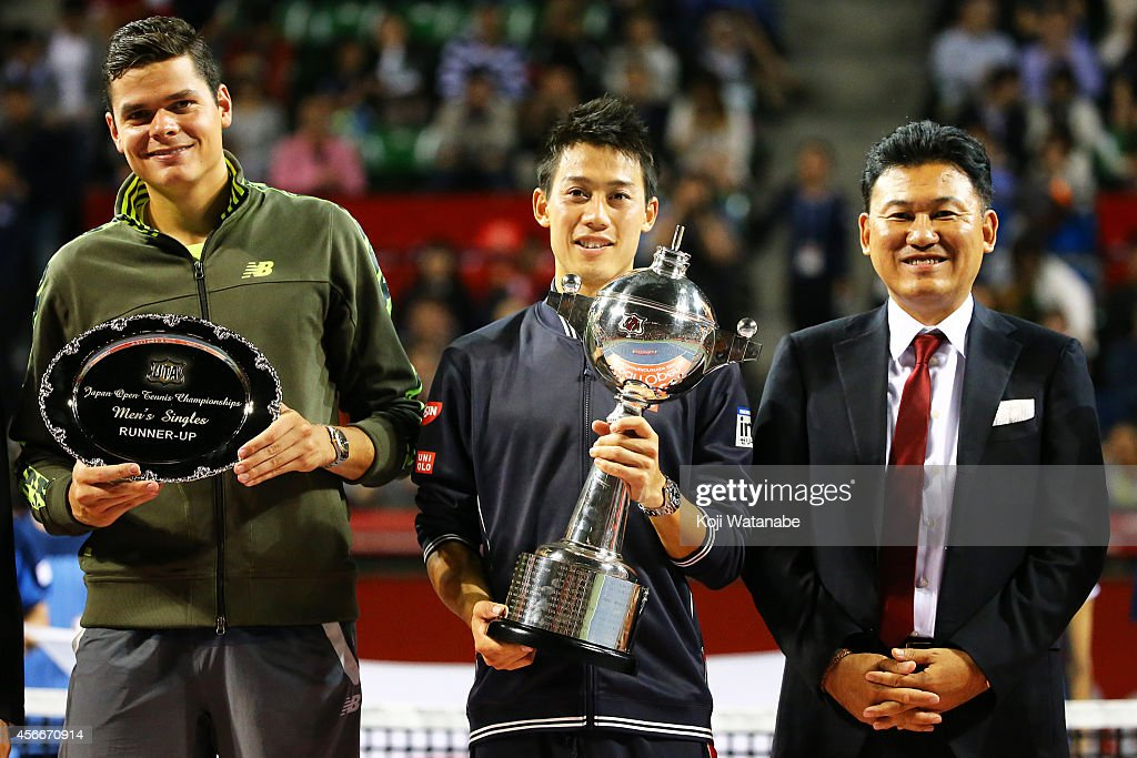 Winner <a gi-track='captionPersonalityLinkClicked' href=/galleries/search?phrase=Kei+Nishikori&family=editorial&specificpeople=4432498 ng-click='$event.stopPropagation()'>Kei Nishikori</a> of Japan (C), runner-up <a gi-track='captionPersonalityLinkClicked' href=/galleries/search?phrase=Milos+Raonic&family=editorial&specificpeople=5421226 ng-click='$event.stopPropagation()'>Milos Raonic</a> of Canada (L) and <a gi-track='captionPersonalityLinkClicked' href=/galleries/search?phrase=Hiroshi+Mikitani&family=editorial&specificpeople=2208204 ng-click='$event.stopPropagation()'>Hiroshi Mikitani</a>, chairman and chief executive officer of Rakuten Inc. poses for photoragraph at the trophy ceremony after the men's singles final match on day seven of Rakuten Open 2014 at Ariake Colosseum on October 5, 2014 in Tokyo, Japan.