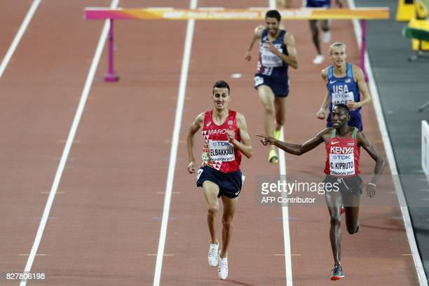 TOPSHOT Winner Kenya's Conseslus Kipruto gestures to Morocco's Soufiane Elbakkali as they race to the finish in the final of the men's 3000m...