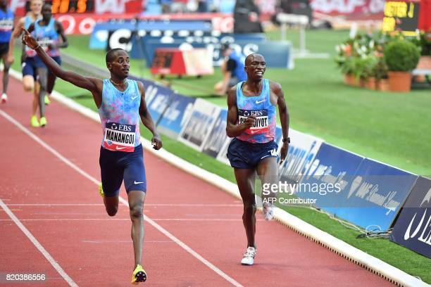 Winner Kenya's Elijah Motonei Manangoi and secondplaced Kenya's Timothy Cheruiyot run past the finish line of the men's 1500m event at the IAAF...