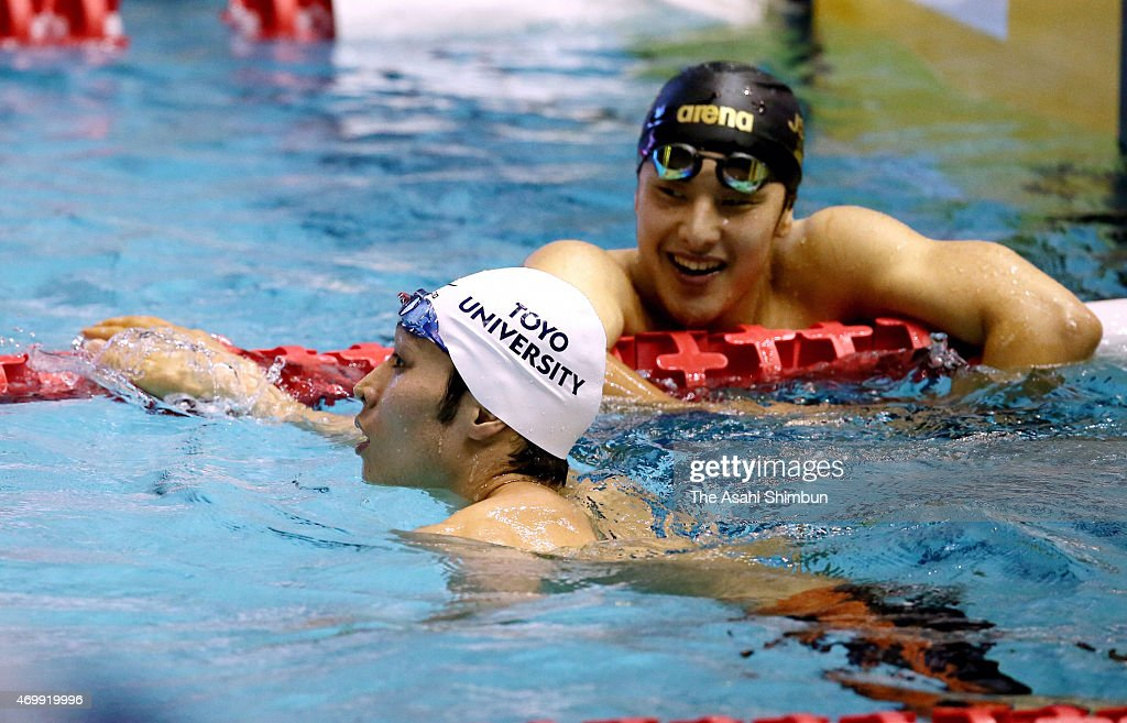 Winner Kosuke Hagino (L) and second place Daiya Seto react after competing in the Men's 400m Individual Medley final during day six of the Japan Swim 2015 at Tokyo Tatsumi International Swimming Center on April 12, 2015 in Tokyo, Japan.