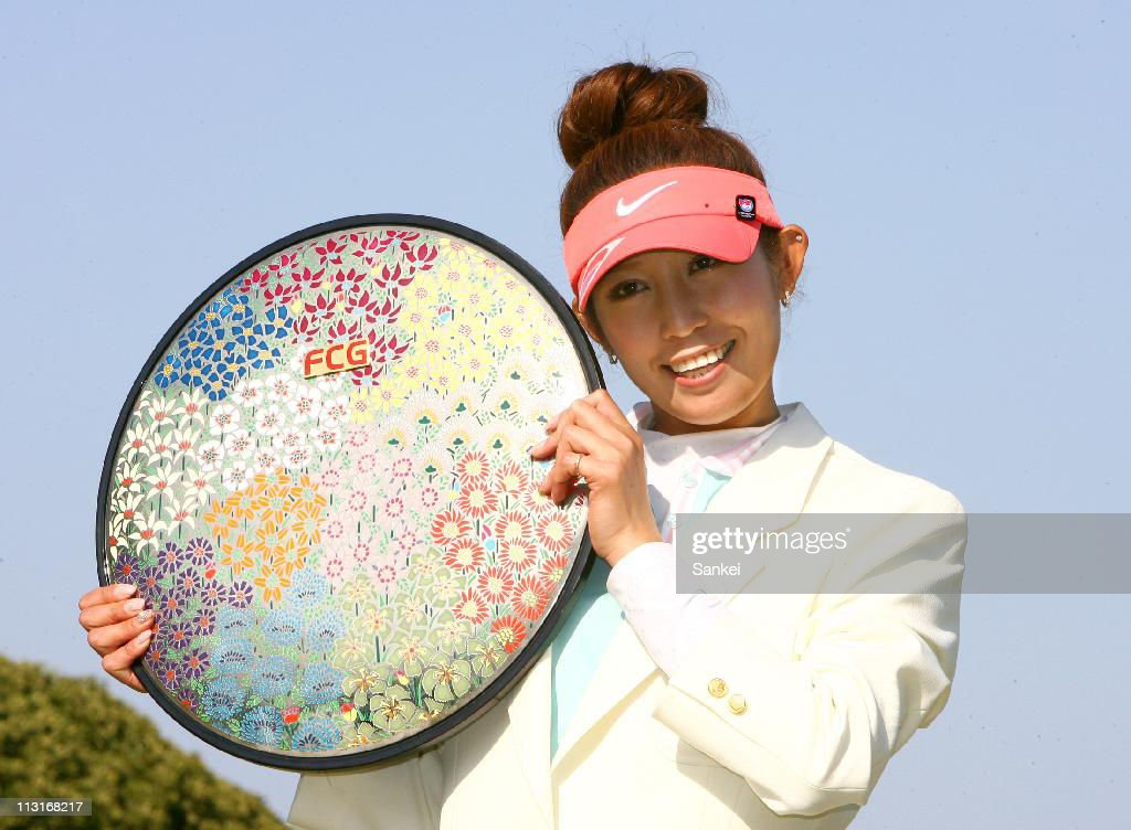 Winner Kumiko Kaneda poses for photographs with the trophy after the final round of the Fuji Sankei Ladies Classic at Kawana Hotel Golf Course on April 24, 2011 in Ito, Shizuoka, Japan.