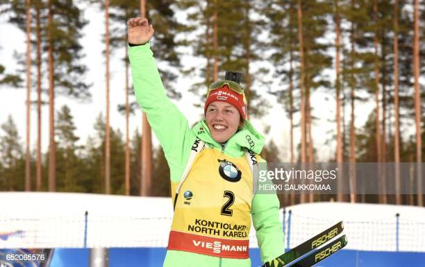 Winner Laura Dahlmeier of Germany celebrates on the podium after the ladies' 10 km pursuit competition at the IBU Biathlon World Cup at Kontiolahti...
