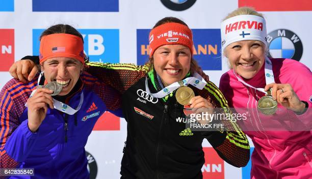 Winner Laura Dahlmeier of Germany celebrates on the podium next to second placed US's Susan Dunklee and third placed Kaisa Makarainen of Finland...