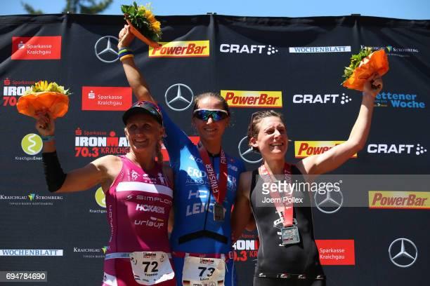 Winner Laura Philipp second place Yvonne van Vlerken and third place Lena Berlinger celebrate after Ironman 703 Kraichgau on June 11 2017 in...
