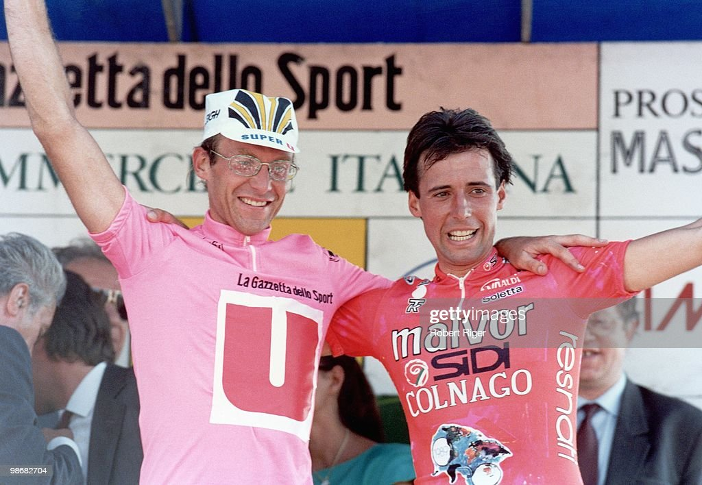 Winner Laurent Fignon of France (l) and runner up Flavio Giupponi of Italy celebrate following the 1989 Giro d'Italia on June 10, 1989 in Italy.