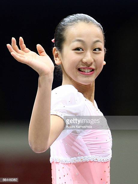 Winner Mao Asada of Japan poses for photographers after competing in the Ladies' event of the Grand Prix of Figure Skating Final 2005/2006 at Yoyogi...