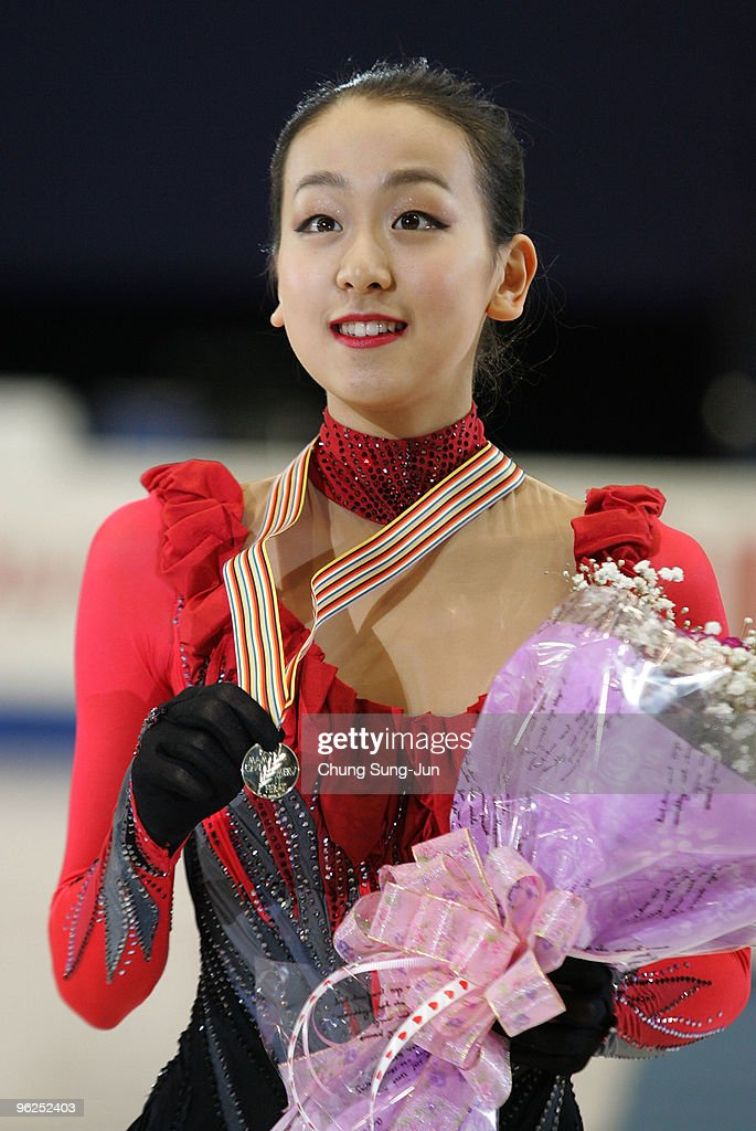 Winner <a gi-track='captionPersonalityLinkClicked' href=/galleries/search?phrase=Mao+Asada&family=editorial&specificpeople=247229 ng-click='$event.stopPropagation()'>Mao Asada</a> of Japan stands after competing in the Ladies free program during the ISU Four Continents Championship at Hwasan Ice Arena on January 29, 2010 in Jeonju, South Korea.