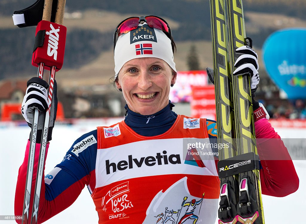 Winner Marit Bjoergen of Norway celebrates after the Ladies 15 km Pursuit Free Tour de Ski on January 8, 2015 in Toblach Hochpustertal, Italy.