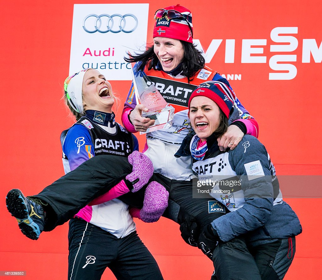 Winner Marit Bjoergen of Norway celebrates at the podium with <a gi-track='captionPersonalityLinkClicked' href=/galleries/search?phrase=Therese+Johaug&family=editorial&specificpeople=4176080 ng-click='$event.stopPropagation()'>Therese Johaug</a> and <a gi-track='captionPersonalityLinkClicked' href=/galleries/search?phrase=Heidi+Weng&family=editorial&specificpeople=8660218 ng-click='$event.stopPropagation()'>Heidi Weng</a> of Norway, ladies 9 km Pursuit Free-Final climb Alpe Cermis Tour de Ski on January 11, 2015 in Val di Fiemme, Italy.