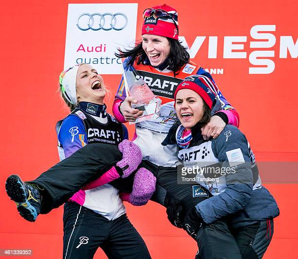 Winner Marit Bjoergen of Norway celebrates at the podium with Therese Johaug and Heidi Weng of Norway ladies 9 km Pursuit FreeFinal climb Alpe Cermis...