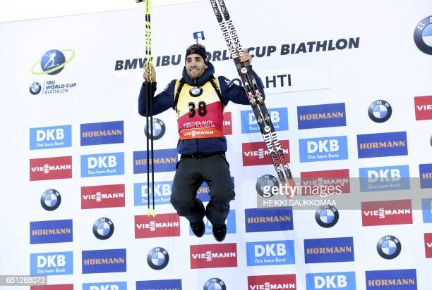 Winner Martin Fourcade of France celebrates on the podium after the men's 10 km sprint at the IBU Biathlon World Cup at Kontiolahti on March 10 2017...
