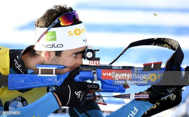 Winner Martin Fourcade of France competes during the men's 10 km sprint at the IBU Biathlon World Cup at Kontiolahti on March 10 2017 / AFP PHOTO /...