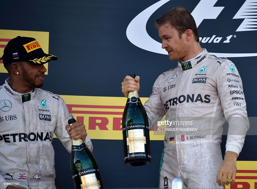 Winner Mercedes AMG Petronas F1 Team's German driver Nico Rosberg (R) and second placed Mercedes AMG Petronas F1 Team's British driver Lewis Hamilton celebrate on the podium after the Formula One Russian Grand Prix at the Sochi Autodrom circuit on May 1, 2016. / AFP / ALEXANDER