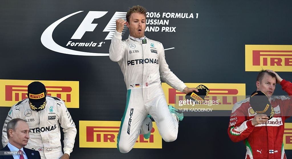 Winner Mercedes AMG Petronas F1 Team's German driver Nico Rosberg (C) celebrates on the podium next to second placed Mercedes AMG Petronas F1 Team's British driver Lewis Hamilton (L) and third placed Scuderia Ferrari's Finnish driver Kimi Raikkonen (R) after the Formula One Russian Grand Prix at the Sochi Autodrom circuit on May 1, 2016. / AFP / YURI