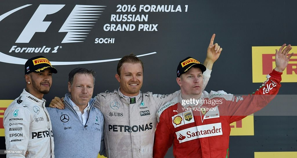 Winner Mercedes AMG Petronas F1 Team's German driver Nico Rosberg (C), second placed Mercedes AMG Petronas F1 Team's British driver Lewis Hamilton (L) and third placed Scuderia Ferrari's Finnish driver Kimi Raikkonen (R) celebrate on the podium after the Formula One Russian Grand Prix at the Sochi Autodrom circuit on May 1, 2016. / AFP / YURI