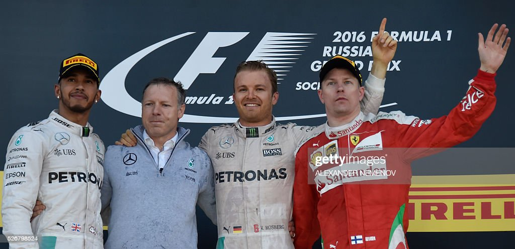 Winner Mercedes AMG Petronas F1 Team's German driver Nico Rosberg (C), second placed Mercedes AMG Petronas F1 Team's British driver Lewis Hamilton (L) and third placed Scuderia Ferrari's Finnish driver Kimi Raikkonen (R) celebrate on the podium after the Formula One Russian Grand Prix at the Sochi Autodrom circuit on May 1, 2016. / AFP / ALEXANDER