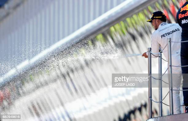 Winner Mercedes' British driver Lewis Hamilton celebrates on the podium winning the Spanish Formula One Grand Prix on May 14 2017 at the Circuit de...