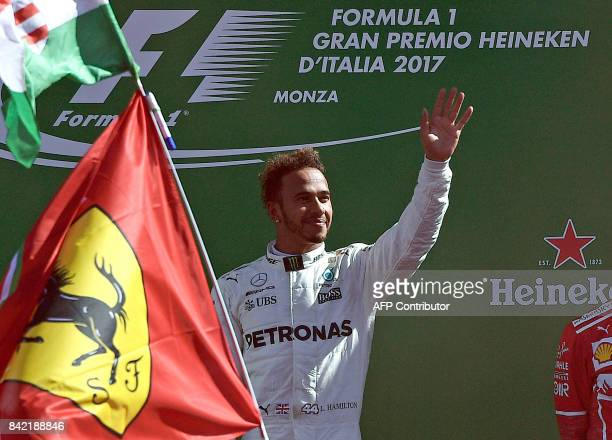 Winner Mercedes' British driver Lewis Hamilton celebrates on the podium after the Italian Formula One Grand Prix at the Autodromo Nazionale circuit...