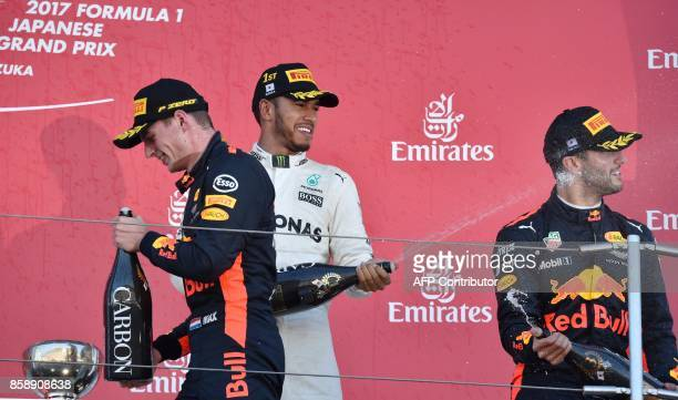 Winner Mercedes' British driver Lewis Hamilton second placed Red Bull's Dutch driver Max Verstappen and third placed Red Bull's Australian driver...
