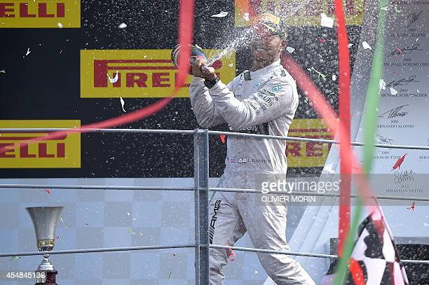 Winner Mercedes' British driver Lewis Hamilton sprays champagne on the podium after the Italian Formula One Grand Prix motor race at the Autodromo...
