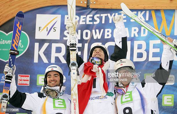 Winner Mikael Kingsbury of Canada and his compatriots second placed Philippe Marquis and third placed MarcAntoine Gagnon celebrate on the podium...