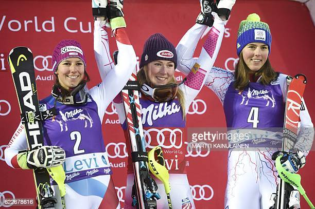 Winner Mikaela Shiffrin of the US second placed Wendy Holdener of Switzerland and third placed Petra Vlhova of Slovakia celebrate on the podium after...